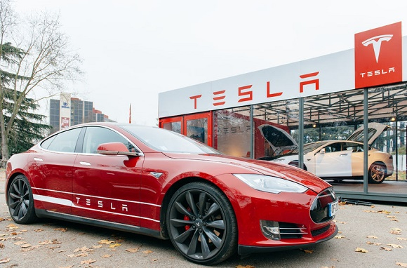 35543463 - paris, france - november 29: new tesla model s showroom has arrived in paris, france. tesla is an american company that designs, manufactures, and sells electric cars
