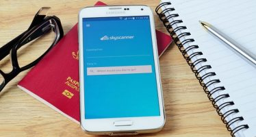 59169584 - kota kinabalu, malaysia - july 1, 2016: skyscanner on mobile app, it help you find cheap flights and airline tickets to your favorite travel destinations so much easier.