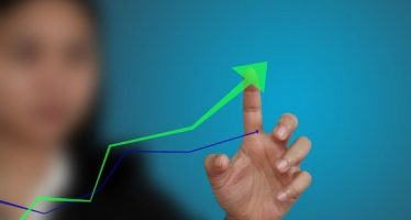 10589868 - business hand point at up trend graph