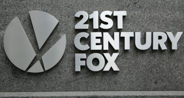 53640638 - new york - march 10, 2016:21st century fox logo in new york. 21st century fox is the world' s premier portfolio of cable, broadcast, film, pay tv and satellite spanning six continents across the globe