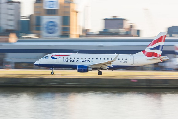 37711864 - london, united kingdom - march 10, 2015: british airways embraer 170 taking off from london city airport. photo taken with panning technique.