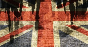 20303385 - conceptual image of shoppers overlaid onto uk flag