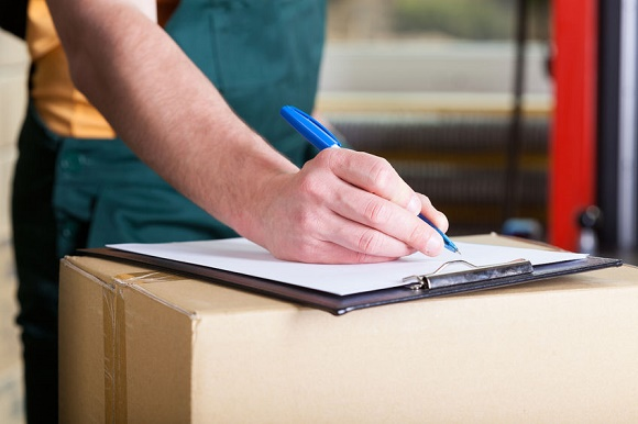 31368652 - close-up of a man's hand signing delivery document