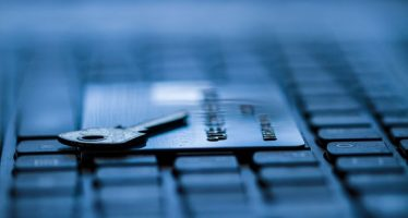 32148347 - credit card and key on keyboard