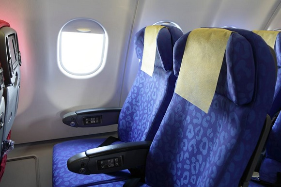 12201531 - airplane blue seat and window inside an aircraft
