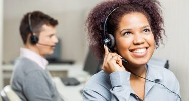39002256 - happy female call center agent using headset in call center