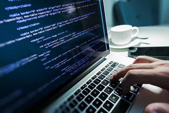 47332506 - programming work time. programmer typing new lines of html code. laptop and hand closeup. working time. web design business concept.