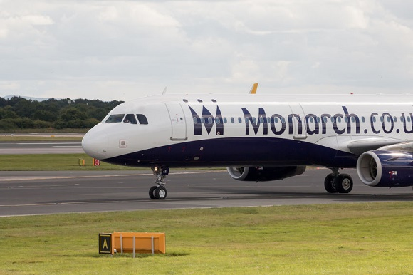 49434413 - monarch airlines airbus a320 narrow-body passenger plane taxiing on manchester international airport taxiway after landing.