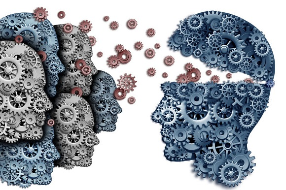 40324180 - employee training a group to lead and learn a team of workers learning from a leader sharing a common strategy and vision for developing work skills for success as gears and cogs shaped as a human head on a white background.