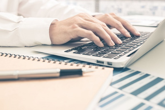 51957263 - man analysis business report. accounting