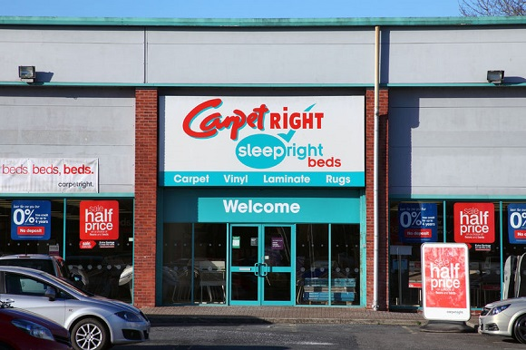 79532516 - carmarthen, wales, uk – january 2, 2017:  carpetright retail stores just outside the town centre