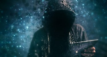 43445277 - pixelated unrecognizable faceless hooded cyber criminal man using digital tablet in cyberspace