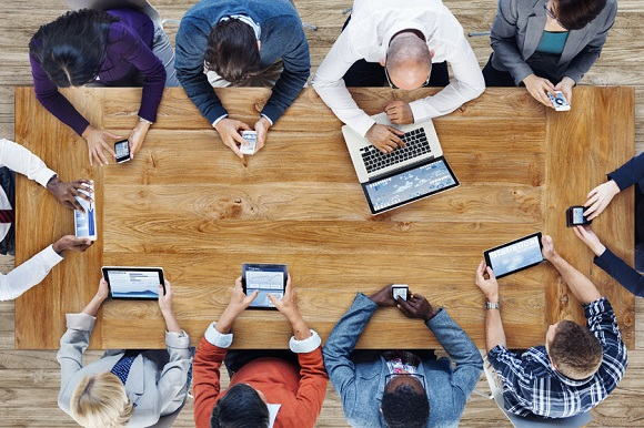 41463868 - group of business people using digital devices