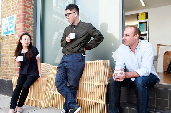84233241 - three architect colleagues taking coffee break outside office