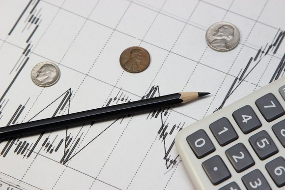 65892458 - calculator, pencil and coins . dow jones index. currency rates on forex