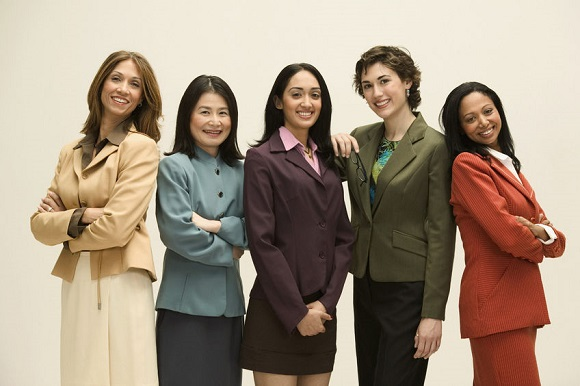 35439621 - group of young businesswomen standing together looking at camera smiling