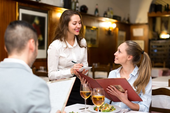 45301973 - hospitable waitress taking an order from a couple in a rural restaurant