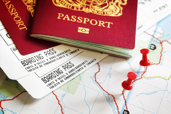 38970374 - boarding pass and passport on map with thumbtack concept for travel and vacations
