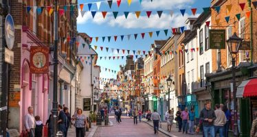 46585597 - rochester, uk - may 16, 2015: rochester high street at weekend. people walking through the street, passing cafes, restaurants and shops